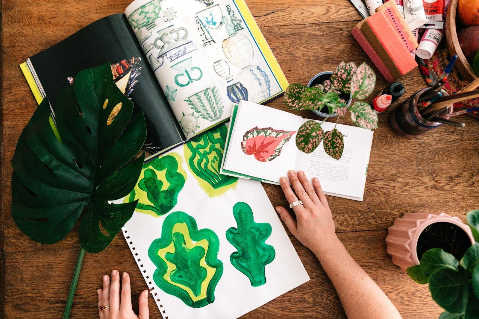 Katy Dee painting botanical elements