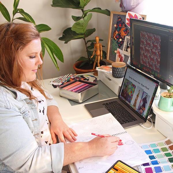 Crystal Kruger sketching designs in her studio